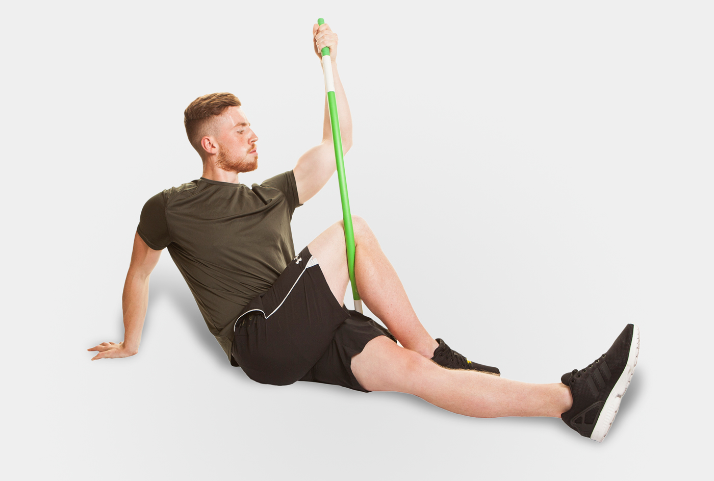 Man using ProFitstick and stretching his legs