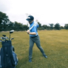 Golfer stretching back out before drive with ProFitstick